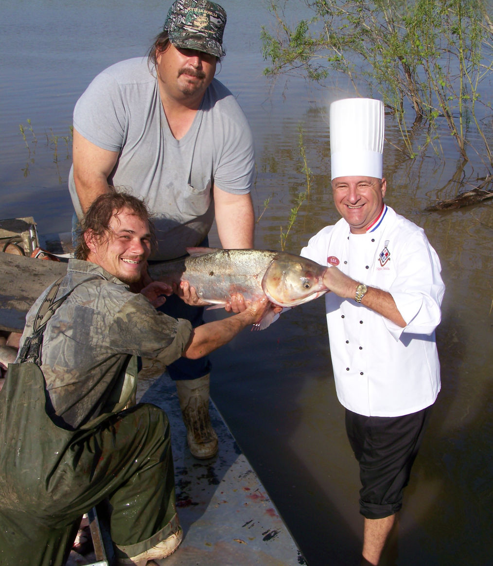 Chef Philippe Parola Getting Asian carp from Commercial Fishermen